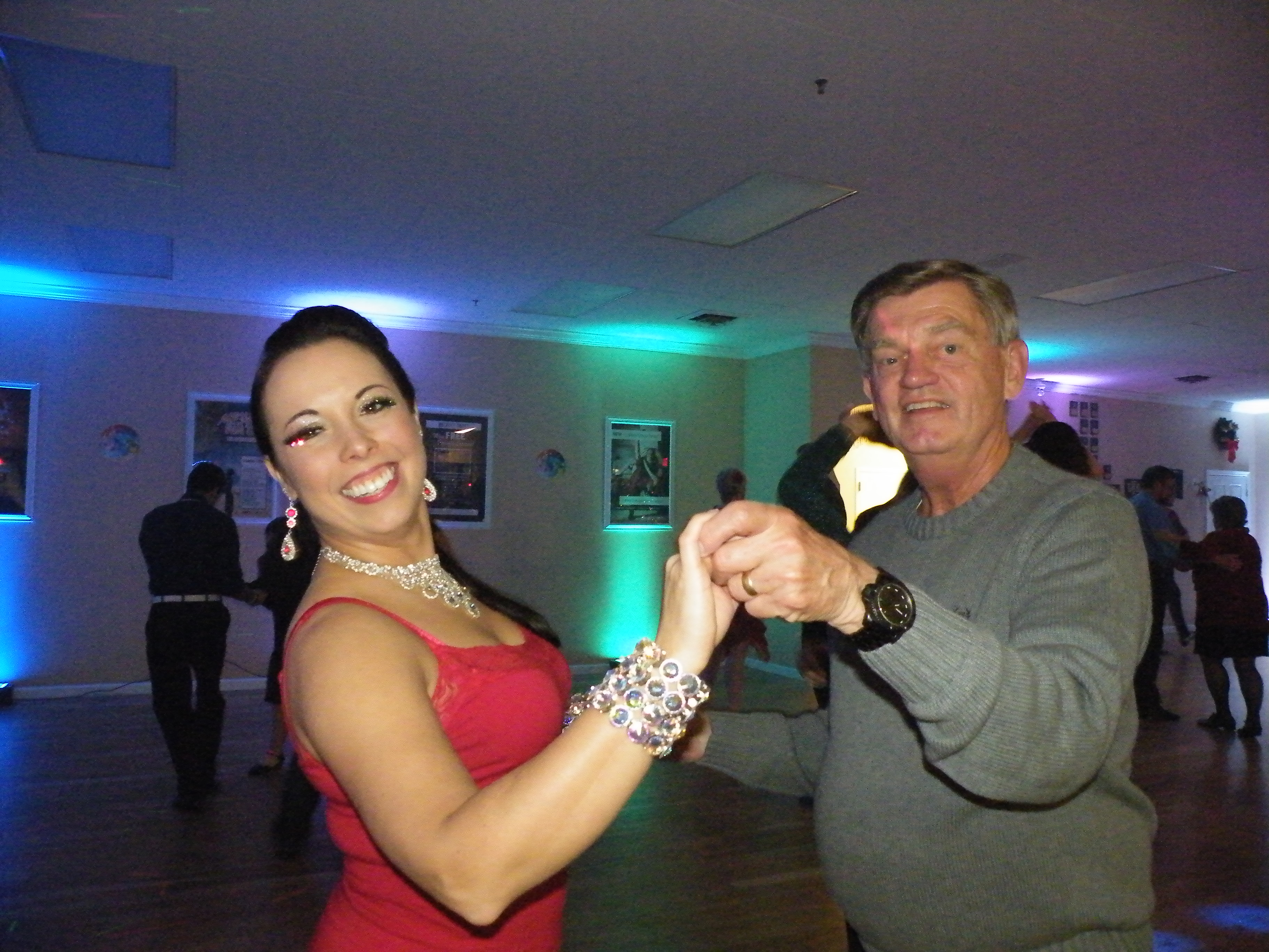 The Owner dancing with a student