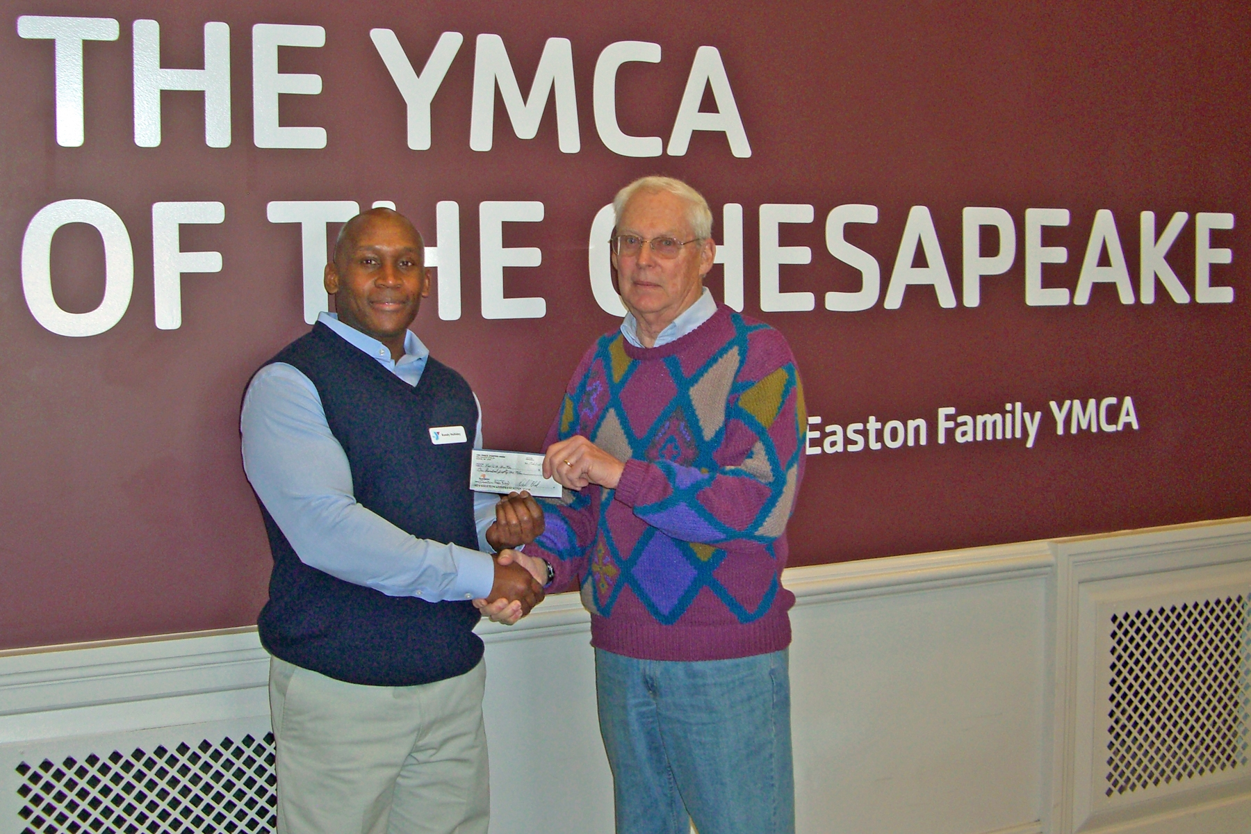 USA Dance President George Drake donating money to the YMCA in Easton